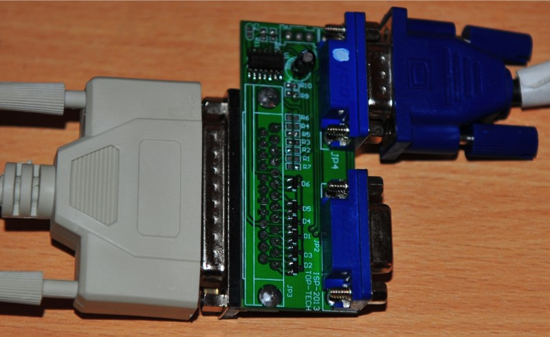 The supported Parallel port programmer. There's more than one design of these, and chances are, they're not all compatible.